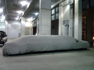 Limousine Under Wraps in a Parking Garage at Silo Point