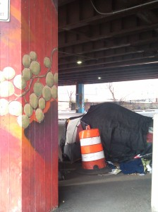 Tent and Safety Barrel Under the JFX at Gay & Fallsway