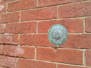 US Coast and Geodetic Survey Benchmark Medallion on School 33 Art Center at Light & Birckhead