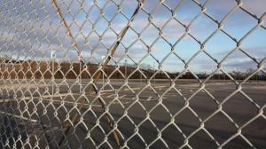 Abandoned Parking Lot on Kloman Street By the Light Rail Tracks