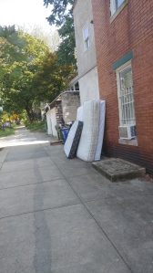 Abandoned Mattresses Against a House at 32nd & Calvert